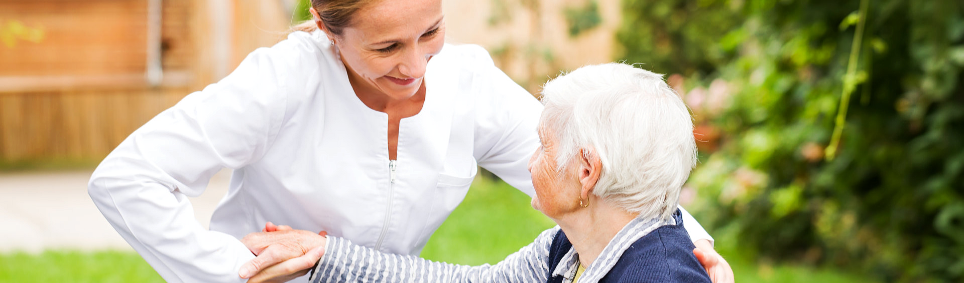 caregiver helping elder